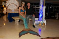 Robert Allenby poses with the mermaid at the Bluewater Golf Invitational.